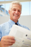 Happy senior businessman reading document Stock Photography