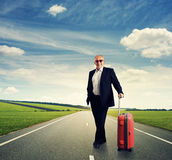 Happy senior businessman with suitcase Royalty Free Stock Photos