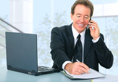 Happy Senior Businessman Working In Office Stock Image