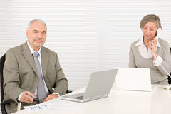 Happy senior businesspeople looking at graphs Stock Photos