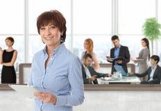 Happy senior businesswoman with working team royalty free stock photos