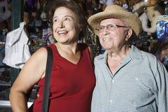 Happy Senior Caucasian Couple At Souvenir Shop Royalty Free Stock Photo
