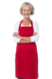 Happy senior chef posing with confidence Royalty Free Stock Images
