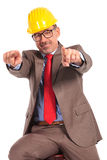 Happy senior construction engineer pointing fingers Royalty Free Stock Image