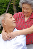 A happy senior couple. An intimate senior couple embraced Stock Image