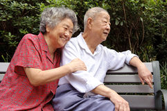A happy senior couple. An intimate senior couple in a garden Stock Image