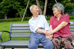 A happy senior couple. An intimate senior couple in a park Stock Photography