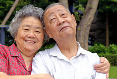 A happy senior couple. An intimate senior couple embraced Stock Photos