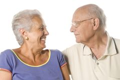 Happy senior couple. Senior married couple looking at each other on white background Stock Photo