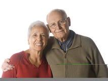 Happy senior couple. A loving, handsome senior couple on a white background Stock Photos