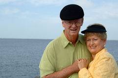Happy senior couple. A happy senior couple outdoors by the ocean royalty free stock photos
