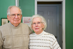 Happy Senior Couple. Attractive happy healthy senior mature couple indoor together stock image