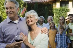 Happy Senior Couple With Arm Around Stock Image