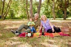 Happy senior couple and baby Stock Image