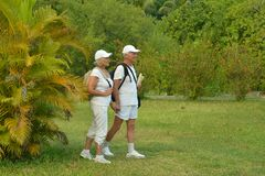 Senior couple with backpacks Royalty Free Stock Images