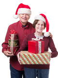 Happy Senior Couple Bearing Christmas Gifts Royalty Free Stock Image