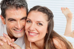 Happy senior couple in bed Stock Image