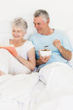 Happy senior couple at bed Stock Photos