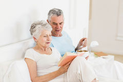 Happy senior couple at bed Royalty Free Stock Photography