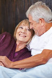 Happy senior couple in bed Stock Photos