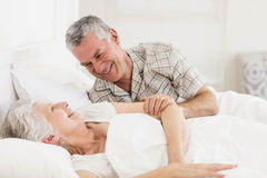 Happy senior couple at bed stock image