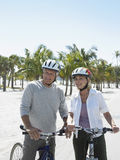 Happy Senior Couple With Bicycles On Beach Stock Image
