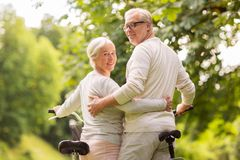 Happy senior couple with bicycles at summer park Stock Photography