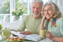 Happy senior couple with book Stock Photo