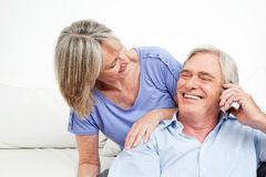 Happy senior couple with cell phone stock photo