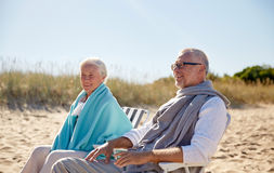 Happy senior couple in chairs on summer beach Royalty Free Stock Images