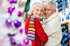 Happy Senior Couple At Christmas Store Royalty Free Stock Photography
