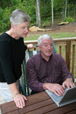 Happy Senior Couple on Computer Royalty Free Stock Photography