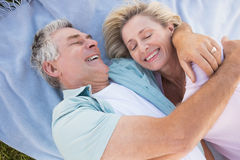 d29f5f1808 Happy senior couple cuddling on blanket. On a sunny day royalty free stock  photos