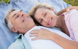 3c9ec6b7a5 Happy senior couple cuddling on blanket. On a sunny day royalty free stock  images