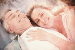 Happy senior couple cuddling on blanket Stock Image