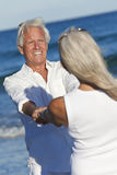 Happy Senior Couple Dancing Holding Hands Beach Royalty Free Stock Photography