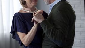 Happy senior couple dancing, looking at each other and smiling, anniversary. Stock photo royalty free stock photography