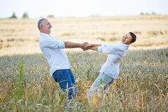 Happy senior couple dancing in summer Royalty Free Stock Photography