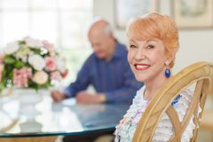 Happy Senior Couple in Diningroom Royalty Free Stock Images