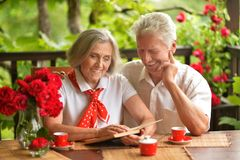 Senior couple drinking coffee. Happy Senior couple drinking coffee on terrace at home stock photography