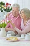 Happy senior couple  drinking tea. With cookies Royalty Free Stock Photography