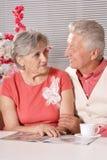 Senior couple reading magazine Stock Images