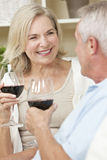 Happy Senior Couple Drinking Wine at Home Royalty Free Stock Photos
