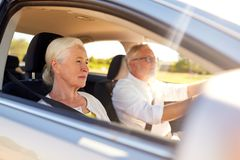 Happy senior couple driving in car Stock Photos