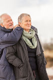 Happy senior couple elderly people together outdoor. In autumn winter Royalty Free Stock Images