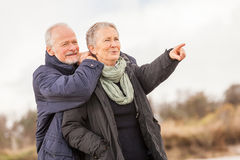 Happy senior couple elderly people together outdoor royalty free stock images