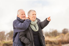 Happy senior couple elderly people together outdoor. In autumn winter Stock Photography