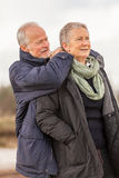 Happy senior couple elderly people together outdoor. In autumn winter Royalty Free Stock Photos