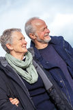 Happy senior couple elderly people together outdoor. In autumn winter Royalty Free Stock Photography