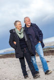 Happy senior couple elderly people together outdoor. In autumn winter Royalty Free Stock Image